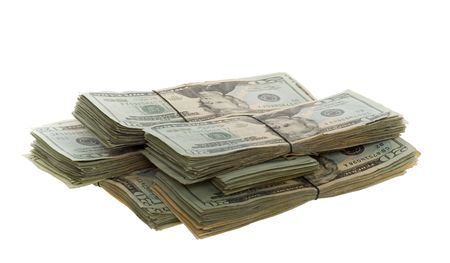 Seven Groups of Twenty Dollar Bills Stacked and Banded Together with a Rubber Band on white background. photo