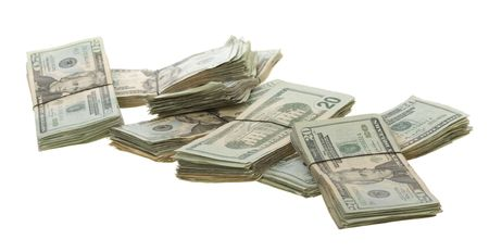 Groups of Twenty American Dollar Bills Banded Together with Rubber Bands spread out on white background. photo