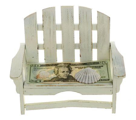 Twenty Dollar Bill on Wooden Chair with Shell photo