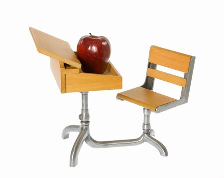 Child's miniature toy, wooden school desk with connected chair and an Apple on top of the desk. isolated on white. Stock Photo - 7827602