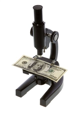 labratory: US Currency One Hundred Dollar Bill being examined under a microscope, isolated on white background. Stock Photo