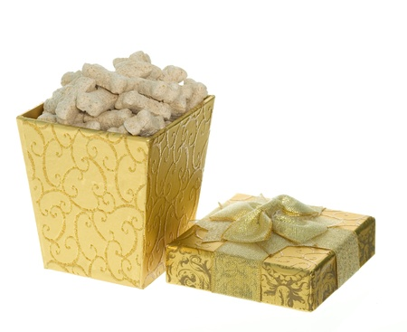Gold Gift Box full of Miniature Milk Bone Dog Treats,  present for a dog. Stok Fotoğraf