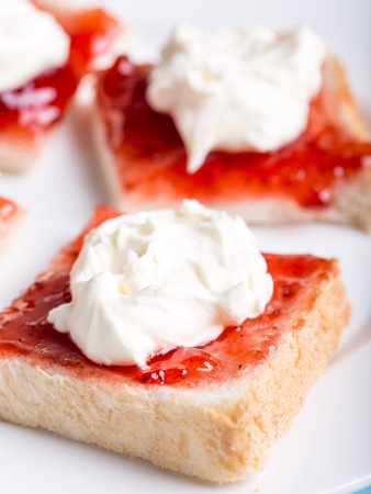 Bread with jam and cream