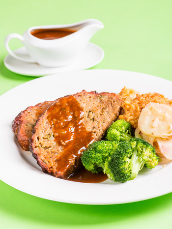 Meatloaf with vegetables and gravy