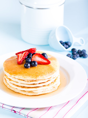 Pancake stack with fresh berries and syrup