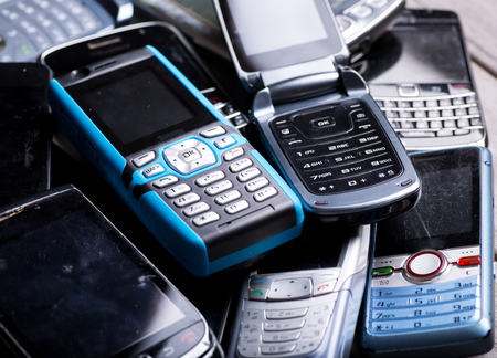 Pile of old phones for recycling Stock Photo