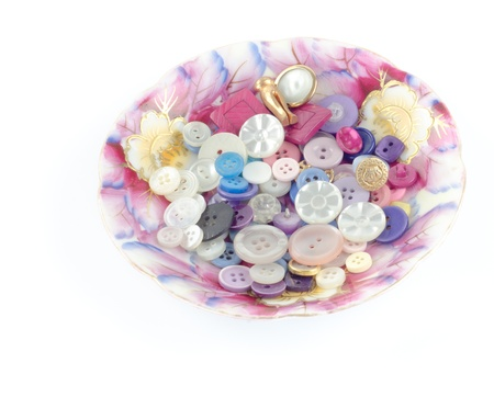 pretty s shiny: Various buttons in a china saucer