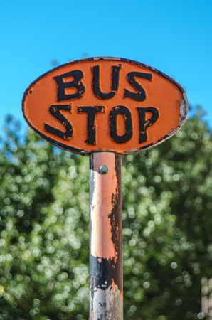An old fashioned bus stop sign in Savannah, Georgia