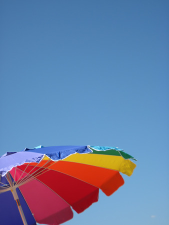 A beach umbrella on a perfectly clear day Stock Photo - 29159896