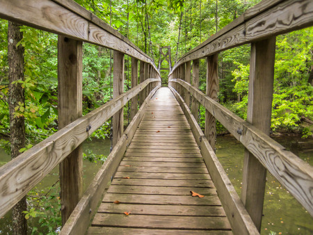 appalachian trail sign: A wooden footbridge on the Appalachian Trail provides safe crossing for hikers over a river