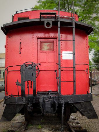 caboose: Bright red caboose at the rear of a train on display in Chattanooga, Tennessee