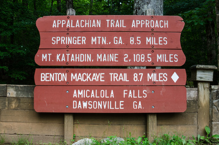 A painted sign gives the distance to Maine from Georgia on the Appalachian Trail