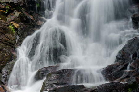 gush: Water gushes over rocks at Amicacola Falls State Park Stock Photo