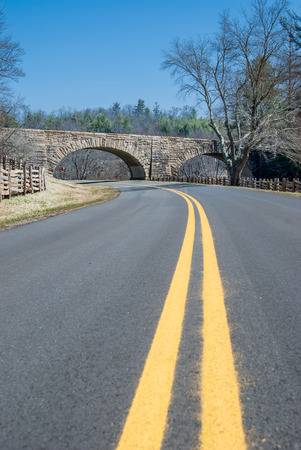 The Blue Ridge Parkway curves to pass underneath a local road