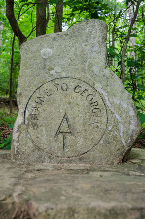 appalachian trail sign: The first sign hikers completing the Appalachian Trail as they embark from its Southern most point near Springer Mountain in Georgia