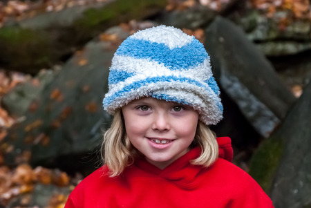 A young girl enjoying nature in winter looks at the camera photo