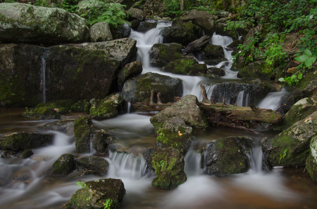 passing over: Water cascading over rocks after passing over Crabtree Falls