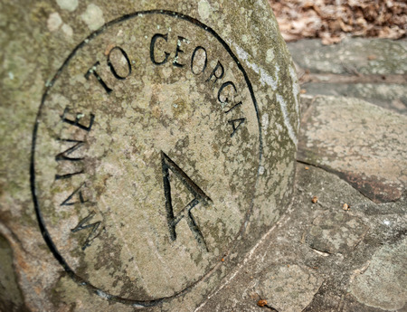 appalachian trail sign: This stone marker indicates the beginning of the AT approach trail from Amicacola State Park to Springer Mountain the the full AT Stock Photo