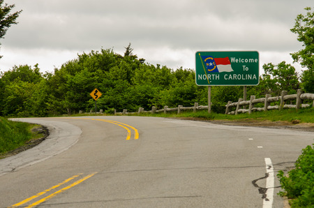 A sign welcomes motorists to North Carolina near Roan Mountain