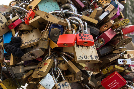 initials: Tourists write their initials on a lock and attach it to a popular bridge over a canal in Amsterdam