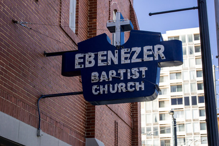 A blue and white sign marks the home of Ebenezer Baptist Church where Martin Luther King Jr. preached in Atlanta Editorial