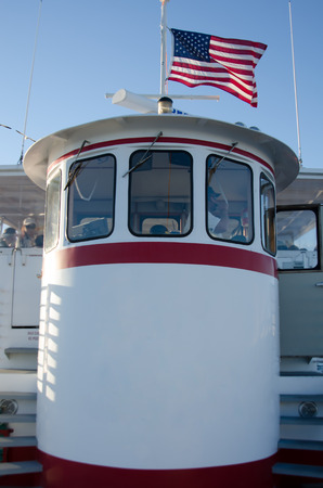 wheel house: An American flag waves on top of a boat taking tourists around the Gulf of Mexico