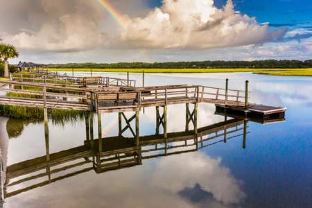 marshy: a rainbow reflects on the waters of a marshy inlet
