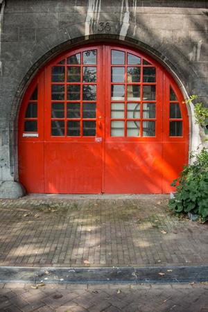 unusually: An unusually shaped round orange door