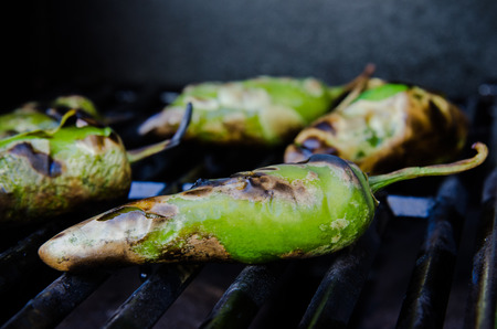 Green peppers roasting on the grill Stock Photo