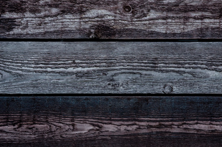 untreated: Untreated and aged wooden boards provide a background image Stock Photo