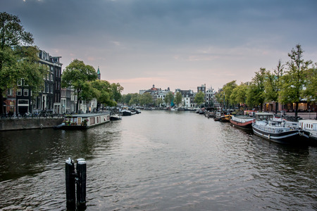 amstel river: A quiet morning along the Amstel River in Amsterdam