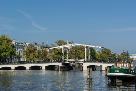 amstel river: A drawbridge pulls up when tall boats need to pass on the Amstel river.