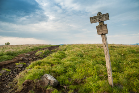 roan: An aged wooden sign marks the elevation of Round Bald on the Appalachian Trail near the border of Tennessee and North Carolina