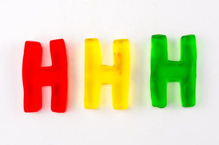 h: A set of three gummy letters in the shape of H isolated on white