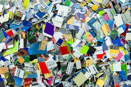 heap up: Expired credit and gift cards chopped up an in a heap Stock Photo