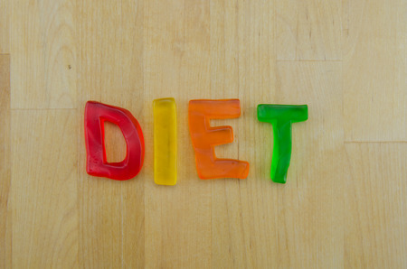 Multi colored gummy letters ironically spell the word diet photo