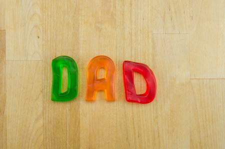 multi colored: Multi colored letters spell the word dad