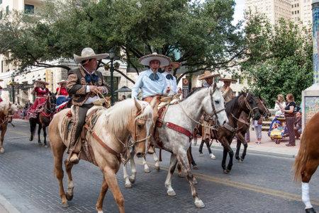 reigns: SAN ANTONIO UNITED STATES JANUARY 29 2011: Latino cowboys herd cows before the San Antonio rodeo