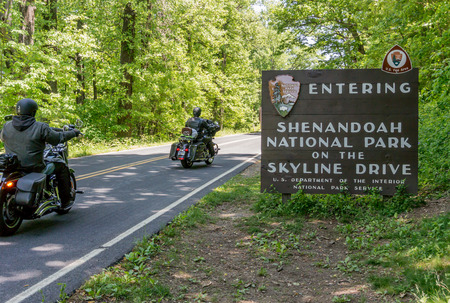 appalachian trail sign: Motorcyclists enter the Shenandoah National Park to coast along Skyline Drive Editorial