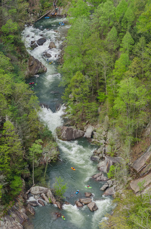 Kayakers enjoy a high release day along the Toccoa River in the Tallulah Gorge