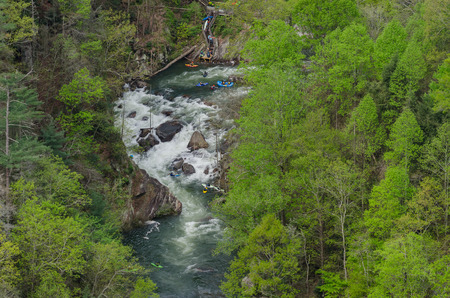 rafters: kayakers and rafters access the Toccoa River on a high release water date