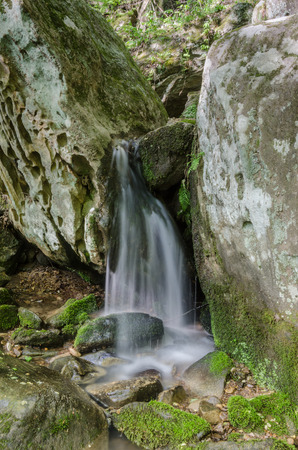 trickles: Water trickles over rocks after tumbling over Anglin Falls in central Kentucky