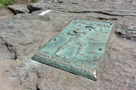 end of the trail: A copper plaque marks the beginning (or end) of the famed Appalachian Trail Editorial