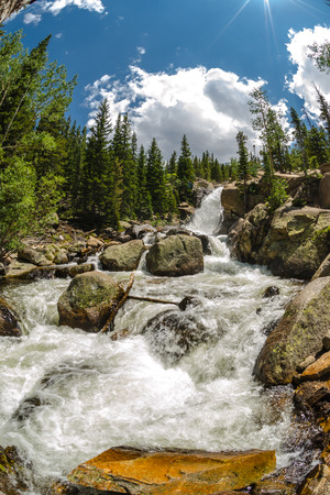 strongly: Albert Falls on a sunny summer day rushes strongly with snow melt Stock Photo