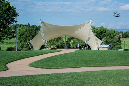 an awning: An awning covers an amphitheater in a public park Stock Photo
