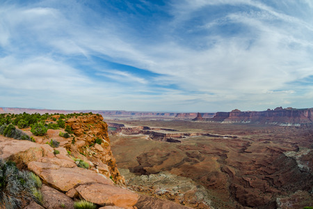 cutting through: View of the Colorado River cutting through the canyon at the end of Murphy Trail in Canyonlands National Park Stock Photo