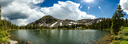 A panorama of a cold mountain lake near Gunnison, Colorado