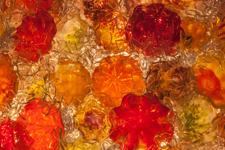 blown: A background image of red, orange, and clear blown glass