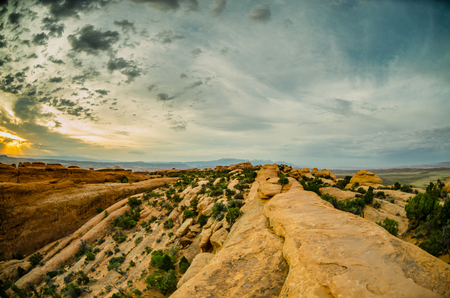 devils garden: A fisheye view of sunrise over the Devils Garden trail in Arches National Park
