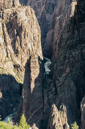 carves: The raging Gunnison River carves through jagged canyons